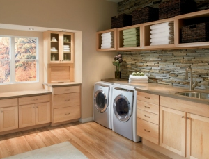 stylish-laundry-room-design-with-oak-wood-cabinet-as-well-as-washing-and-drying-machines-plus-natural-stone-exposed-backsplash-also-glass-window-and-laminate-wooden-floor